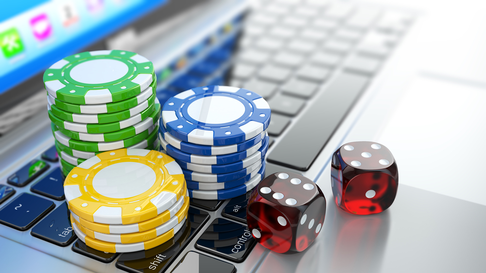 Laptopn With Casino Ships And Dice