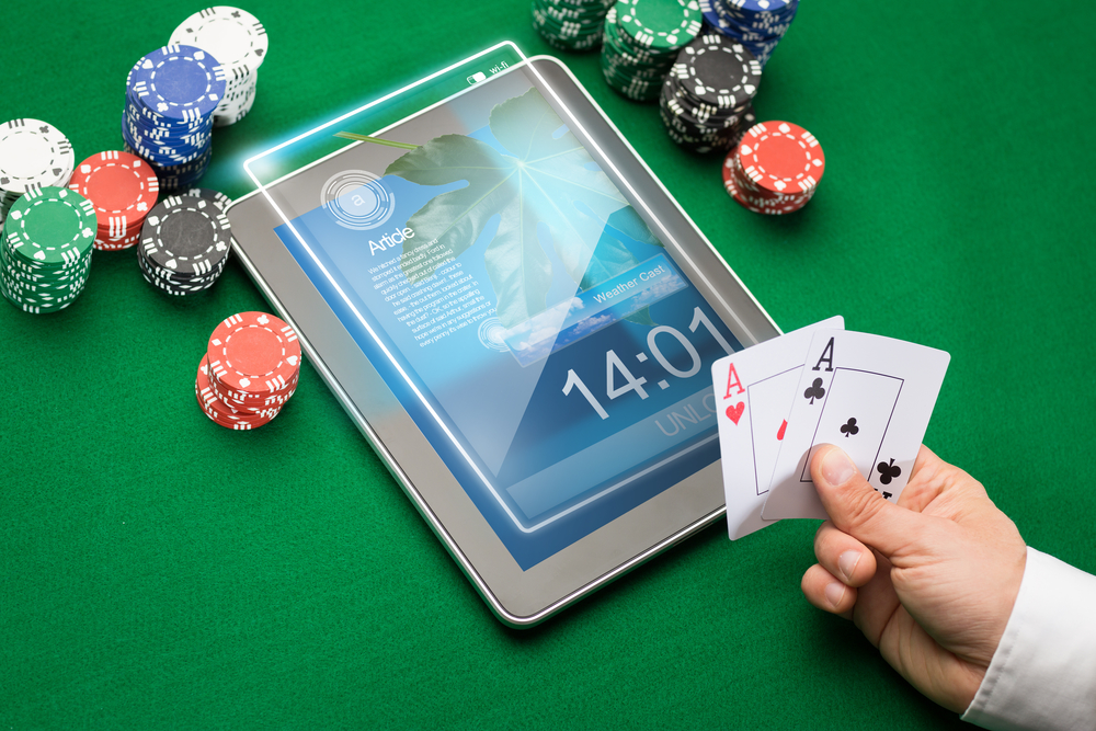 Internet Casino Player With Tablet & Chips